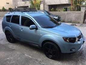 Selling Mitsubishi Outlander 2009 Automatic Gasoline in Binmaley