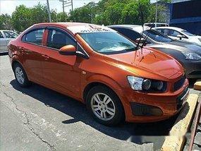 Orange Chevrolet Sonic 2015 at 30303 km for sale