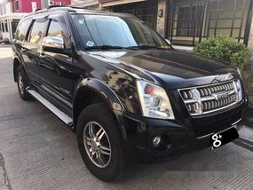 Black Isuzu Alterra 2009 at 54000 km for sale