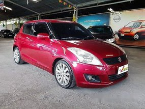 Red Suzuki Swift 2011 at 61000 km for sale