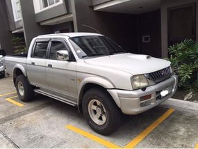 White Mitsubishi Strada 2001 for sale in Quezon City