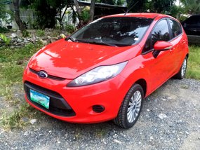 Red Ford Fiesta 2012 at 35000 km for sale
