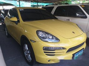 Yellow Porsche Cayenne 2012 at 14000 km for sale