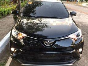Selling Black Toyota Rav4 2016 Automatic Gasoline in Quezon City