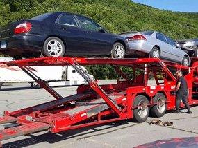 Attach a car onto a trailer in 9 easy steps