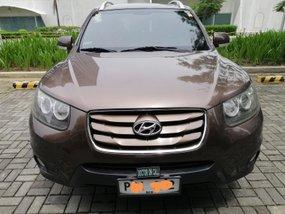 Brown Hyundai Santa Fe 2010 for sale in Quezon City