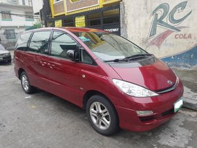 Red 2005 Toyota Previa at 95000 km for sale in Makati