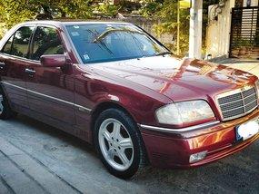 Selling Red Mercedes-Benz C220 1996 Sedan at 115000 km