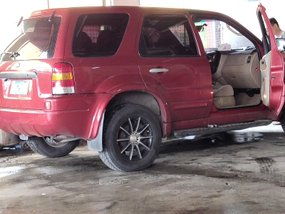 Red Ford Escape 2005 at 124000 km for sale in Cavite