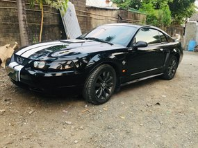 Black Ford Mustang 1999 at 50000 km for sale