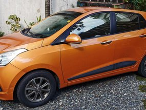 Sell Orange 2015 Hyundai Grand i10 Hatchback at 31000 km
