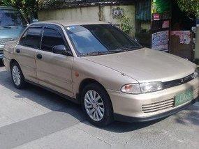Beige Mitsubishi Lancer 1993 Manual Gasoline for sale