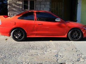 Selling Red Mitsubishi Lancer 1998 Manual Gasoline