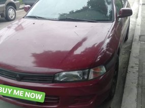 Selling Red Mitsubishi Lancer 1997 at 100000 km