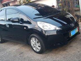 Selling Black Honda Jazz 2012 Hatchback at 68000 km
