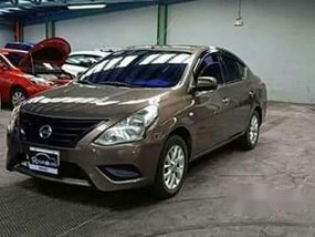 Brown Nissan Almera 2016 at 56000 km for sale