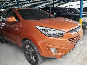 Orange Hyundai Tucson 2014 Automatic Gasoline for sale