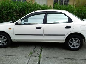 White 1998 Mazda 323 for sale in Quezon City