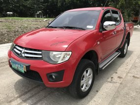 Red 2013 Mitsubishi Strada Truck at 24000 km for sale