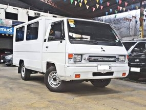 Sell White 2015 Mitsubishi L300 at 13000 km in Quezon City