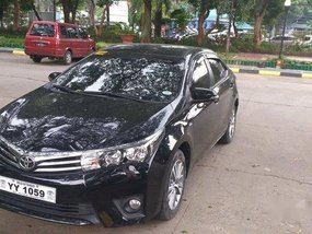 Sell Black 2016 Toyota Corolla Altis at 13000 km