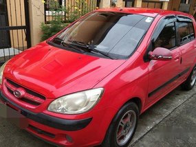Selling Red Hyundai Getz 2007 at 140000 km