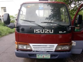 Selling Red Isuzu Elf 2009 Truck in Cavite