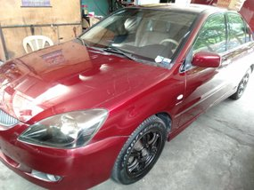 Red 2004 Mitsubishi Lancer for sale in Quezon City