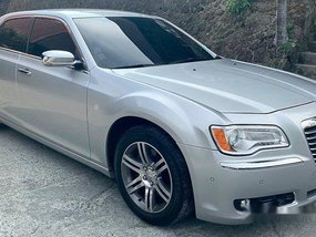 Silver Chrysler 300c 2013 at 30000 km for sale