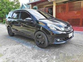 Selling Black Honda Mobilio 2015 Automatic Gasoline at 30000 km