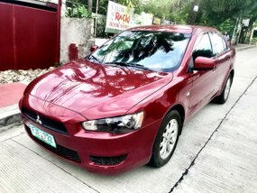 Sell Red 2013 Mitsubishi Lancer at 68000 km
