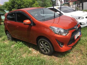 Orange Toyota Wigo 2018 for sale in Cainta