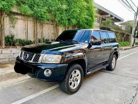 Selling Black Nissan Patrol 2009 at 58000 km