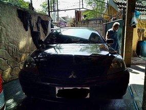 Selling Black Mitsubishi Lancer 2010 Manual Gasoline at 115000 km