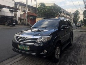 Selling Black Toyota Fortuner 2013 at 24952 km