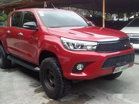 Red Toyota Hilux 2016 at 20000 km for sale