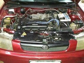 Selling Red Mazda 323 1999 Manual Gasoline in General Salipada K. Pendatun