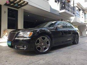 Black Chrysler 300c 2013 at 30000 km for sale
