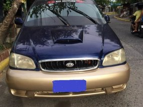 Blue Kia Carnival 2001 at good price in Cavite