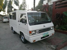 Sell White 2012 Mitsubishi L300 in Quezon City