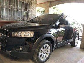 Selling Black Chevrolet Captiva 2014 at 24800 km
