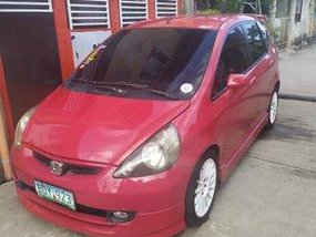 Red Honda Fit 2000 for sale in Cavite