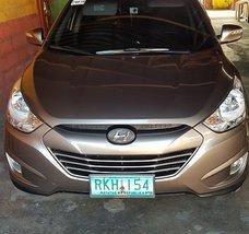 Brown Hyundai Tucson 2011 at 32000 km for sale