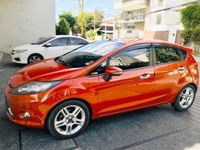 Orange Ford Fiesta 2013 Hatchback for sale in Quezon City