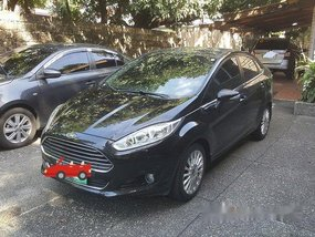 Black Ford Fiesta 2014 at 64000 km for sale