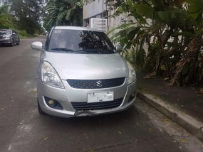 Sell Silver 2014 Suzuki Swift in SM City Bicutan