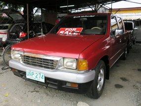 Sell Red 1997 Isuzu Fuego in Imus City