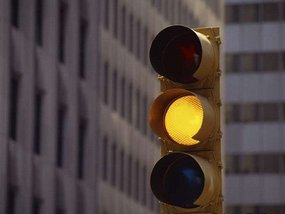 What does a blinking yellow traffic light mean?