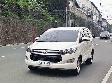 A Toyota Innova on the road