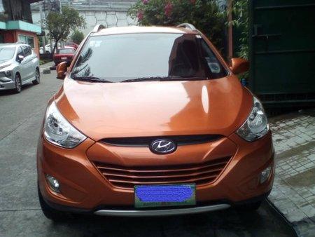Orange Hyundai Tucson 2013 at 40000 km for sale